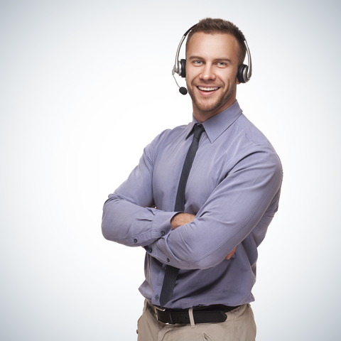 HostLight Client services team contact in a tie on a headset.